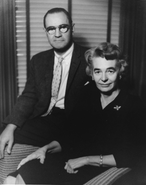 A black and white photo circa 1951 of Patrick and Aimee Mott Butler seated in an office. Patrick is slightly behind Aimee.